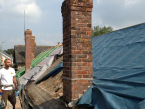 Old chimney waiting to be dismantled at Payhembury School.